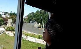 Laureen noumea cumming in front of open window